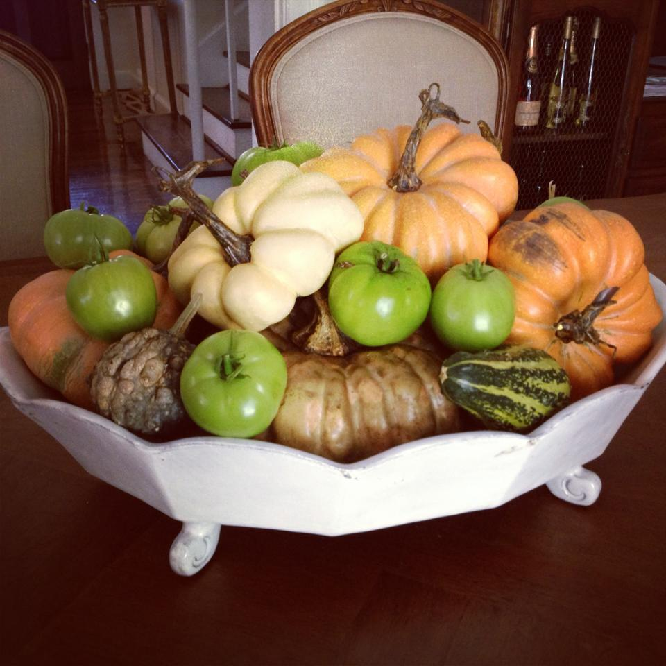 Green tomatoes add a beautiful constant to your orange and white pumpkins.